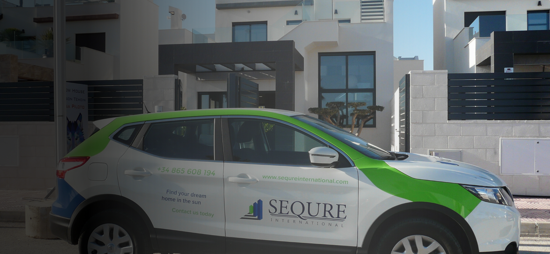 sequre international pool car infront of a 3 storey townhouse style villa in spain